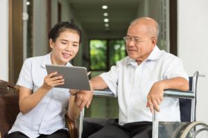 Nurse and an Old Man on a wheelchair